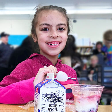 Elementary school student eating breakfast in the classroom in Amherst