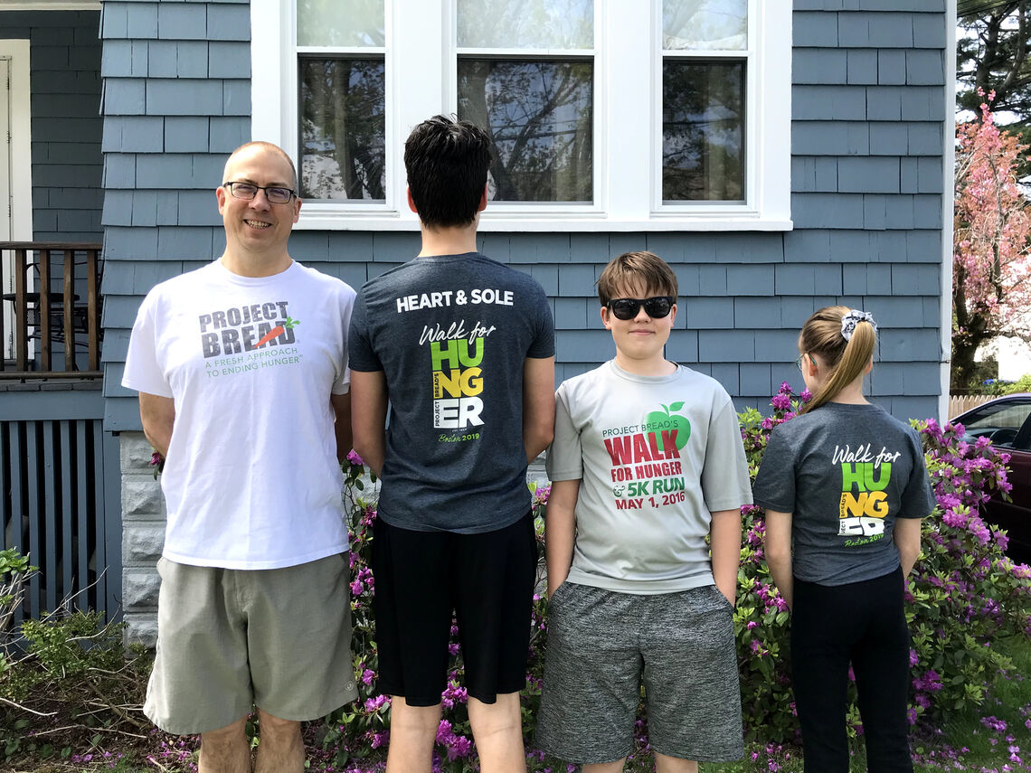 The Cluggish Family models their collection of walk tee shirts at the virtual Walk for Hunger in 2020