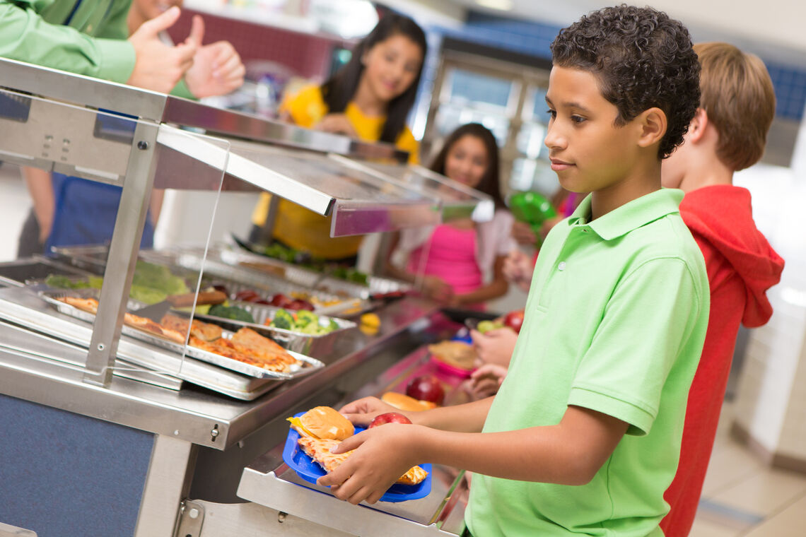 child in school cafeteria line